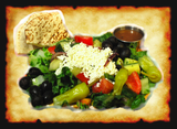 Crisp Romaine Lettuce & a Gourmet blend of various types of leaf lettuce and greens. topped with our Dill-cucumber salad & covered with Feta Cheese & Olives