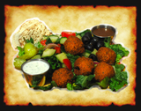 Vegetarian Falafels served on a bed of Crisp Romaine Lettuce & a Gourmet blend of various types of leaf lettuce and greens. topped with our Dill-cucumber salad & & Olives